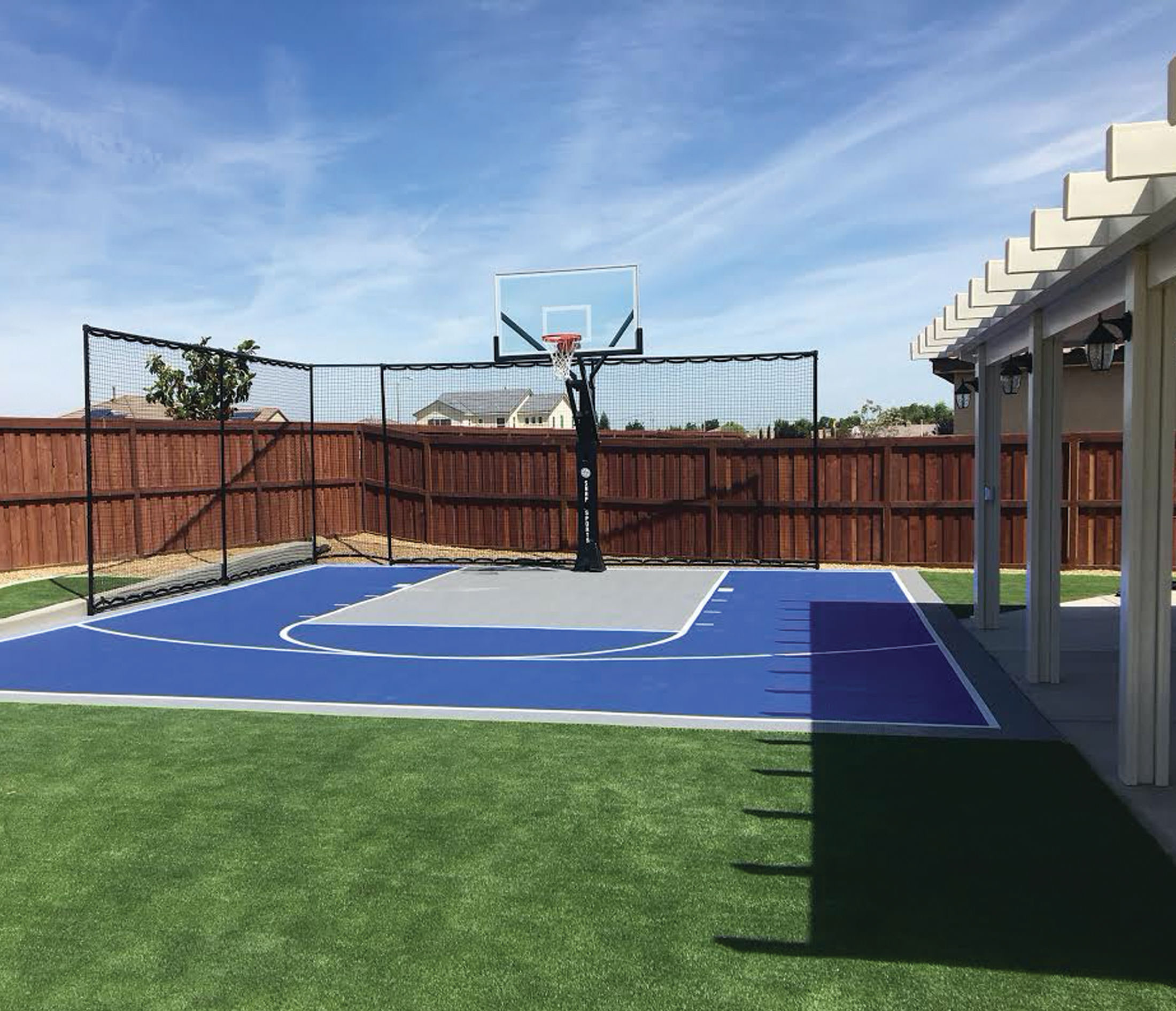 courts and greens basketball court in backyard